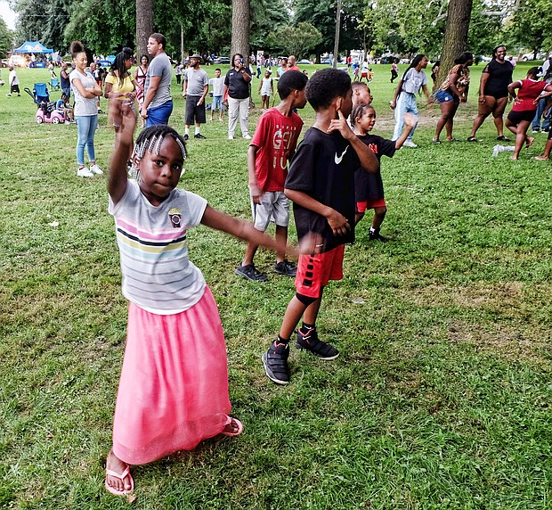 Hundreds of people across metro Richmond turned out Tuesday night for the 35th Annual National Night Out, an event observed across the country to promote safe neighborhoods while building police-community relations. McGruff the Crime Dog and the Richmond Police Department's top brass and officers made the rounds at several of dozens of events put on by neighborhood and community groups across the city, including the one pictured here at Pollard Park in North Side. Camya Brown, 7, shows off her dance moves during the event.