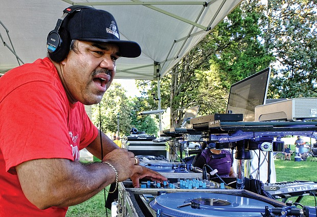 """DJ Tony Fernandez spins high-energy house music Saturday at the 3rd Annual RVA Soul House Fest held at St. Joseph's Villa. The free event, a community party, featured six DJs and a host of entertainers serving up a variety of """"house music,"""" a mix of soul and R&B."""