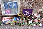 Flowers adorn the curbside memorial Saturday in Charlottesville's downtown where 32-year-old Heather Heyer was killed and dozens of others were injured on Aug. 12, 2017, by a white nationalist who drove his car into a crowd of counterprotesters.
