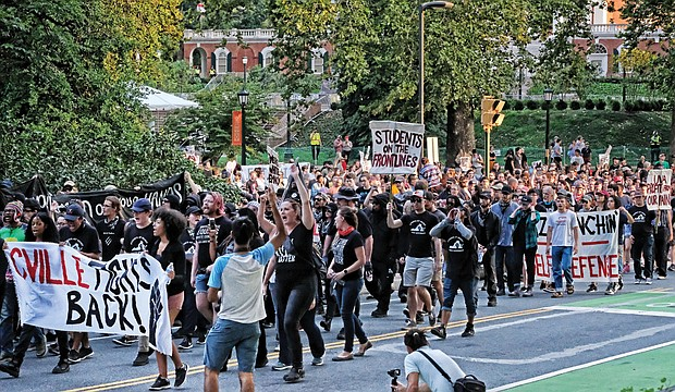 Hundreds of students and activists march down Rugby Road in Charlottesville on Saturday, marking the year anniversary of the bloody violence that broke out during last year's rally by white supremacists, Ku Klux Klan and neo-Nazis.