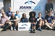 Portland City Council candidate Jo Ann Hardesty (center) meets with her volunteers and poses for a campaign photo Saturday during door-to-door canvassing in southeast Portland.  The longtime Portland activist and former state legislator uses a grassroots style as her main campaign strategy.