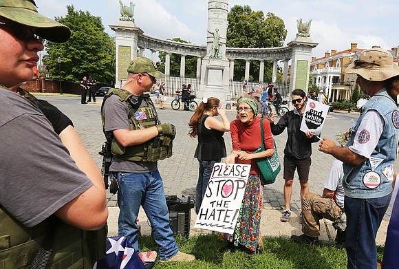 """Tear these racist statues down!"" Those words, shouted by about 40 counterprotesters on Monument Avenue, drowned out attempts by about ..."