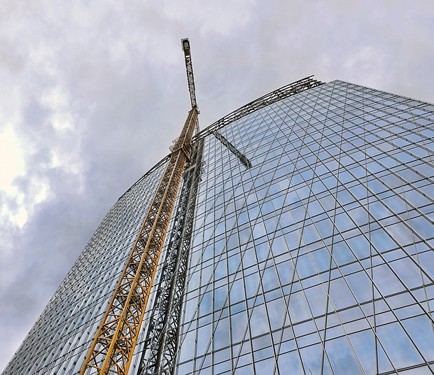 A towering crane's reflection almost looks like a staircase rising up the side of this 20-story Downtown building under construction for Dominion Energy in the block bounded by 6th, 7th, Canal and Cary streets. Crews and cranes have been at the site since work began last year. The building will be known as 600 Canal Place when it opens next year. Dominion Energy has presented plans to a construct a second building to replace its 21-story Virginia headquarters, One James River Plaza, located next door at 701 E. Cary St.