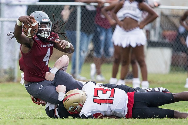 Virginia Union University wide receiver Olu Izegwire, left, is taken down by Seton Hill University's Daquan Glover during last Saturday's opening game at Hovey Field.
