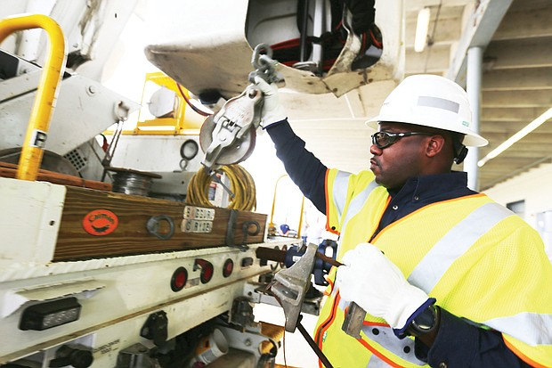 Dominion Energy's Dennis McDade of Fairfax packs his truck Wednesday morning as he prepares for the job ahead of restoring electric power to homes and businesses in the wake of Hurricane Florence. Mr. McDade said this is the 13th or 14th hurricane he has worked through.