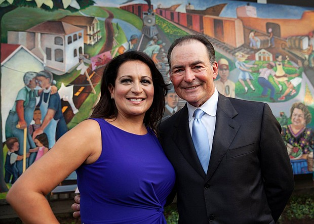 Christina Morales and Orlando Sanchez in front of the Mexican-American History & Culture in 20th Century Houston mural