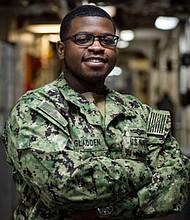 Petty Officer 3rd Class Jarrell Gladdenserves as a Navy cryptologic technician (technical) class aboard the Iwo Jima, an amphibious assault ship.