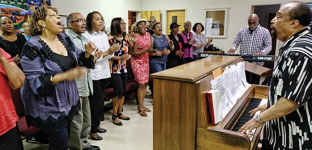 Larry Bland rehearses with choir members last Saturday at Second Baptist Church to get ready for the 11 a.m. worship service Sunday, Sept. 30, at St. Peter Baptist Church in Henrico County.