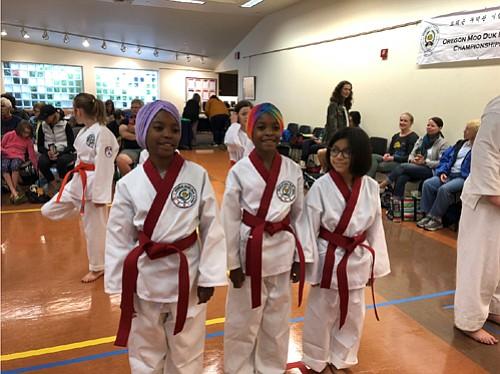 Portland martial arts students Olivia Edwards-El (left), Gracie Edwards-El, and Angelie Fitz-Cortez participate in competition.