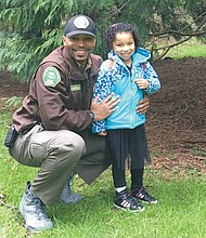 Vicente Harrison, a ranger with Portland Parks and Recreation, is pictured at Washington Park with his daughter Harper.