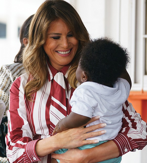 First Lady Melania Trump laid a wreath at a 17th century slave fortress in Ghana on Wednesday, vowing never to ...