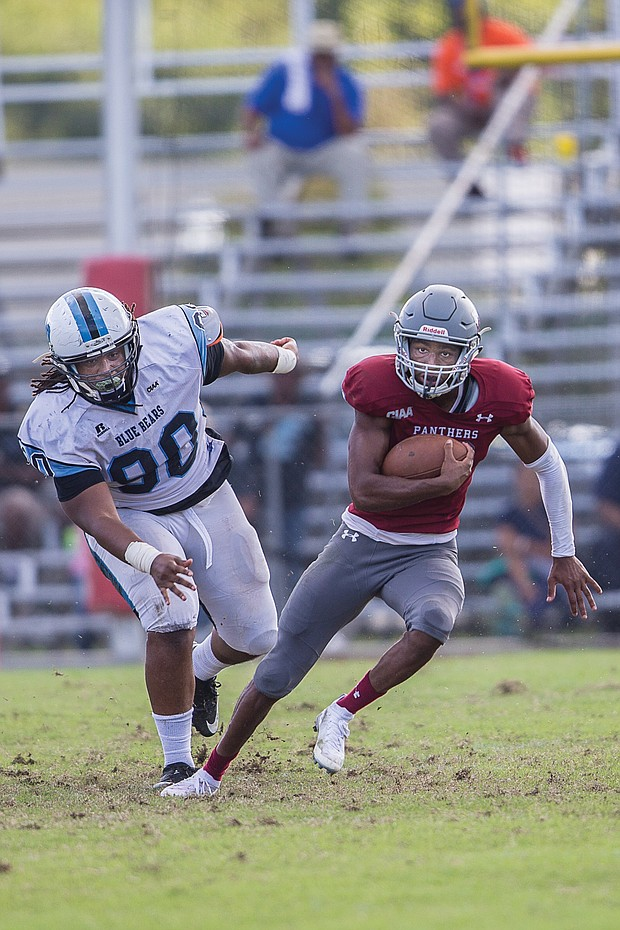 Panthers quarterback Darius Taylor streaks past Livingstone College's William Moore Jr. during last Saturday's game at Hovey Field. Virginia Union University won the game 52-19.