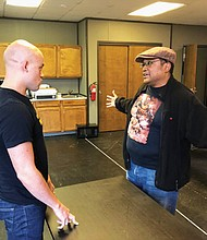 Actor Seth Rue (left) and director Bobby Bermea tackle issues of race and class in the groundbreaking, one-person play 'Fires in the Mirror' from Portland's Profile Theater and showing Oct. 10 through Oct. 21 at Artists Repertory Theatre, downtown.