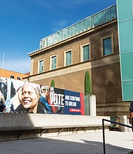 """The banner """"Vote and Continue to Dream"""" by acclaimed African American artist and Portland native Carrie Mae Weems is raised outside the Portland Art Museum to promote participation in the democratic process and upcoming midterm election."""