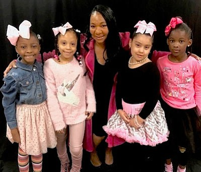 These  children  from God's Little Angles Academy are the ambassadors for the event. They are posing with Kimberly Salley. founder of God's Little Angels.