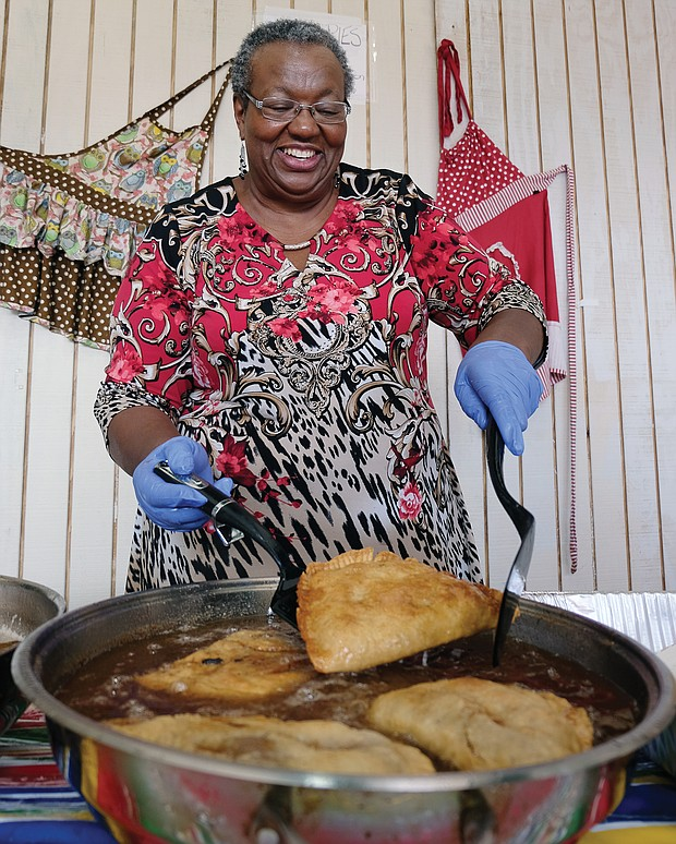 Frances Davis of Rocky Mount demonstrates the art of making fried apple pies during the Richmond Folk Festival. (Sandra Sellars/Richmond Free Press)