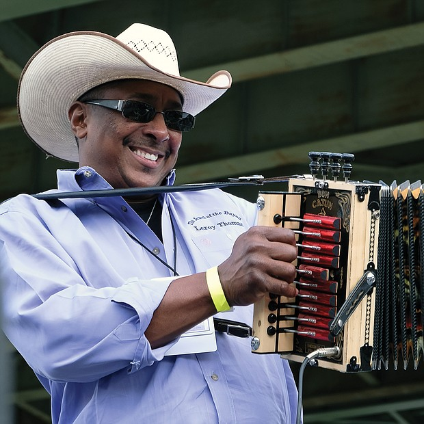 Leroy Thomas & the Zydeco Roadrunners of Elton, La., have spectators dancing with the unique accordion sound at the Richmond Folk Fest. (Sandra Sellars/Richmond Free Press)