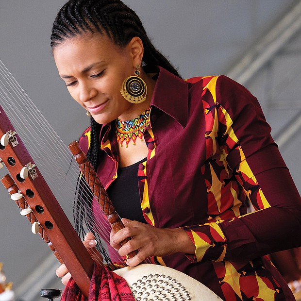 Sona Jobarteh of Gambia is one of the first female virtuosos on the 21-string kora, an instrument played mostly in West Africa. Richmond's riverfront was alive with music last weekend for the 14th Annual Richmond Folk Festival. Thousands of people flocked to the free, three-day festival where more than 30 performers and entertainers from around the globe were on seven stages. (Sandra Sellars/Richmond Free Press)