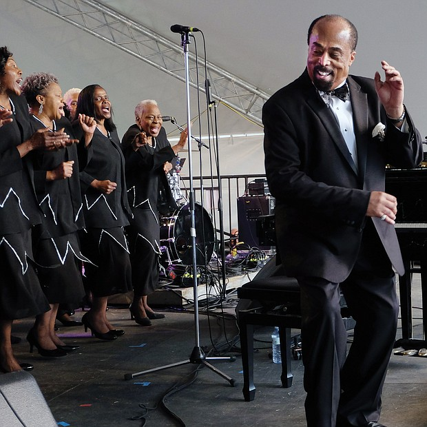 Larry Bland and the Volunteer Choir provide a performance to remember last Sunday, the Richmond Folk Festival's final day. (Sandra Sellars/Richmond Free Press)
