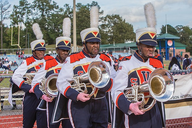 Hundreds of old friends, classmates and their families reunited at Virginia State University last weekend to celebrate homecoming 2018. Members of the VSU Trojan Explosion Marching Band march in focused formation during the game. (James Haskins/Richmond Free Press)