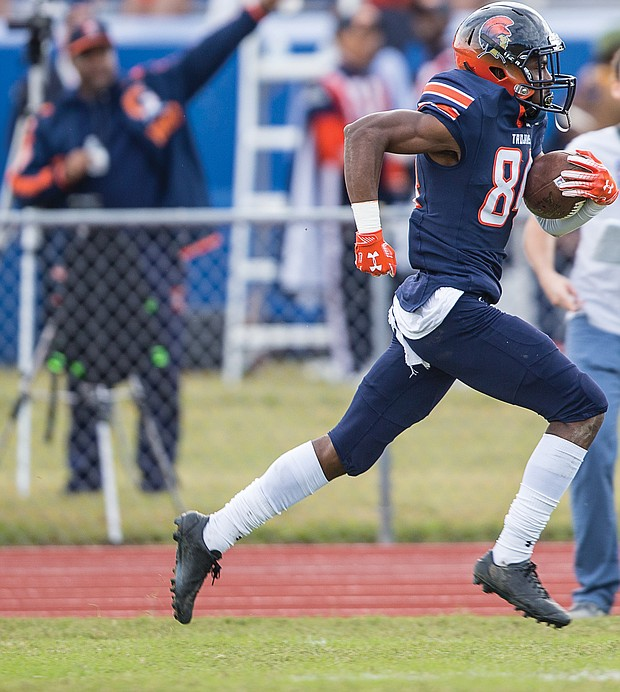 Virginia State University freshman Jemourri La Pierre goes in for a touchdown — one of three he is credited with — during last Saturday's homecoming game against Lincoln University at Rogers Stadium in Ettrick.