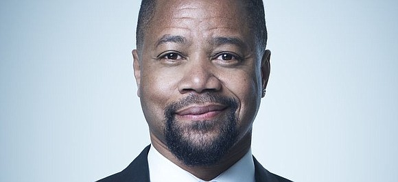 Cuba Gooding Jr. turned himself in to police Thursday and was charged with forcible touching after a woman accused the ...