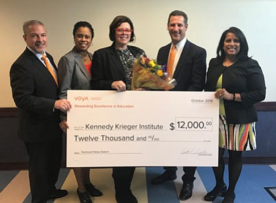 """(Left to right) Voya's Doug Peters and advisor Alicia Kong, along with Mark Jackowitz and Sarala Katta, both of Voya Financial, surround Deidre Rabuck (center), Voya's 2018 Unsung Heroes program second-place $12,000 grant award winner. Rabuck is an assistant principal at the Kennedy Krieger School: Fairmount Campus in Baltimore and she plans to use the grant award to help bring """"Fairmount News Station"""" to life at her school."""