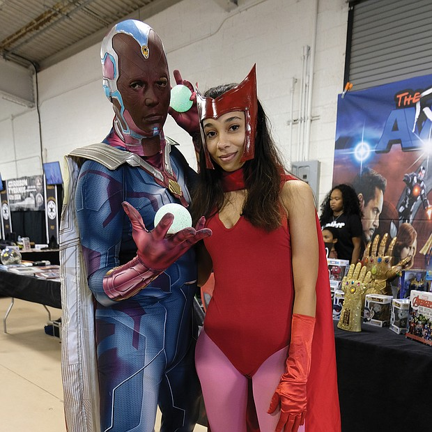 """Superheroes, unite! Scores of people dressed as their favorite comic book heroes and heroines for the 2018 VA Comicon, a two-day extravaganza for comic book fans and lovers of comic book culture. Thousands flocked to the event at the Richmond Raceway last Saturday and Sunday that featured a costume contest both days. Above, Frank Lester and Romaine Ball turn out dressed as """"Vision"""" and """"Scarlet Witch."""" (Sandra Sellars/Richmond Free Press)"""