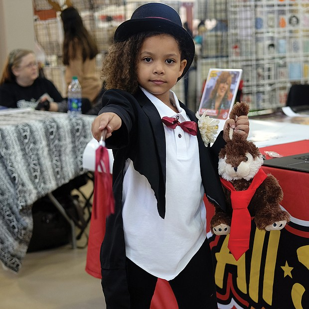 I put a spell on you: Wands, rabbits and other tricks are just the tip of the iceberg for Violette Brown. No, she wasn't dressed for Halloween. She was dressed for 2018 VA Comicon, a two-day event held last weekend at the Richmond Raceway. (Sandra Sellars/Richmond Free Press)