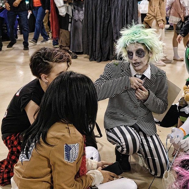 Superheroes, unite! Scores of people dressed as their favorite comic book heroes and heroines for the 2018 VA Comicon, a two-day extravaganza for comic book fans and lovers of comic book culture. Thousands flocked to the event at the Richmond Raceway last Saturday and Sunday that featured a costume contest both days. A costumed group prepares for the judging. (Sandra Sellars/Richmond Free Press)