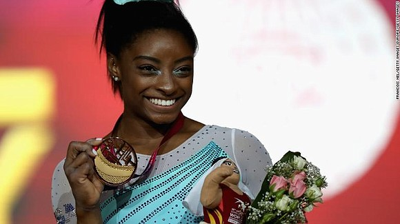 Simone Biles has won the all-around title at the world championships for the fourth time, the most ever in women's ...