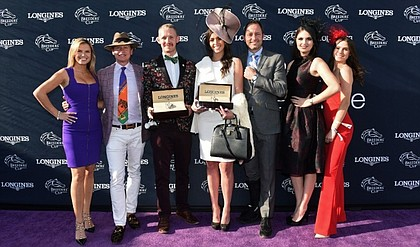 Mattias Dylan Horseman, center left, of Austin, Texas, and McKenzie Marcinek, center right, of Lexington, Kentucky, pose with judges Jane Motion, daughter of Kentucky Derby-winning trainer Graham Motion, TV personality Carson Kressley, Pascal Savoy, Brand President for Longines U.S., Bri Mott, of Fashion at the Races, and Sophie Flay, daughter of Bobby Flay, after they won the Longines Prize for Elegance contest at the 2018 Breeders' Cup, Saturday, Nov. 3, 2018, at Churchill Downs in Louisville, KY.