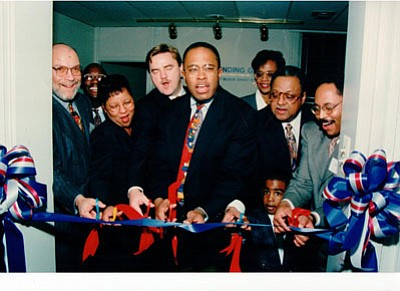 "Opening of the Charles Street office of Development Credit Fund (Front row, left to right): Daniel P. Henson, III: Diane Bell-McKoy; former Baltimore mayor, Kurt L. Schmoke; Ackneil M. Muldrow, II; Harold D. Young; and grandson, Charles ""Chaz"" Scott"