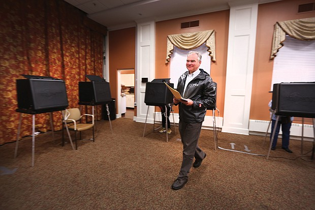 After marking his ballot, U.S. Sen. Tim Kaine of Richmond heads to the machine to cast his vote at Precinct 203 inside The Hermitage Richmond continuing care retirement community on Westwood Avenue in North Side. He and has wife, Anne Holton, have voted at the precinct for the last 28 years. The Democrat easily won re-election over GOP challenger Corey Stewart.