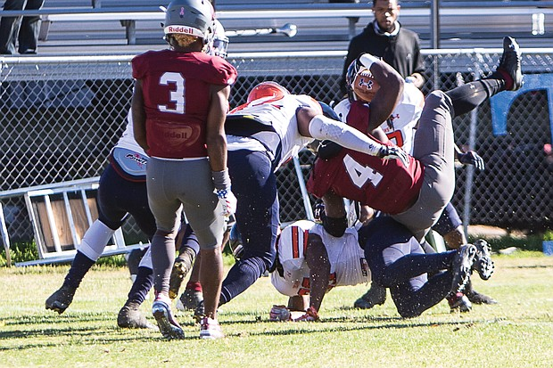 Virginia Union University's Olu Izegwire, a senior wide receiver in the No. 4 jersey, gets pounded as he powers into the end zone during last Saturday's game against the Virginia State University Trojans at Hovey Field in Richmond.