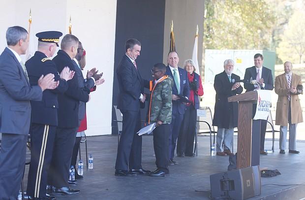 Gov. Ralph S. Northam congratulates Martene Whiting Jr.