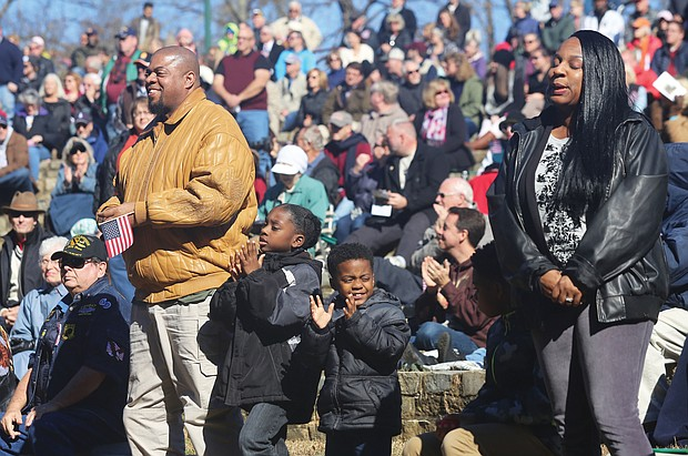 Armistice Day: Martene Whiting Jr.'s parents, Martene and Samantha Whiting, above, both Air Force veterans, stand as the crowd recognizes them during the ceremony. Clapping for their older brother are Emmanuel, 7, and Danuel, 5. (Regina H. Boone/Richmond Free Press)