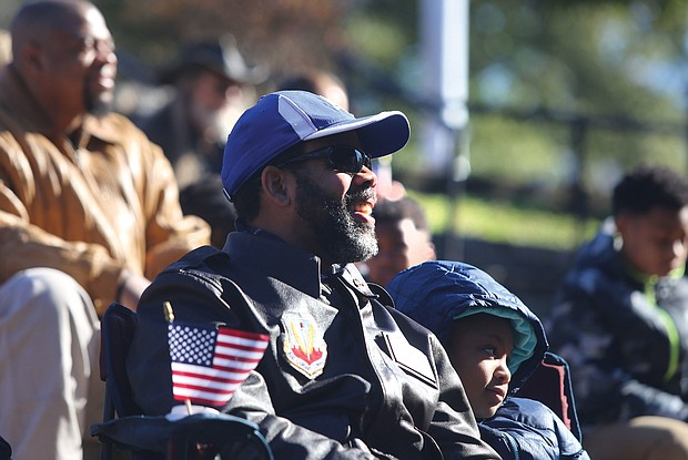 Commissioner John L. Newby II, with the Department of Veteran Services of the Commonwealth of Virginia participates in the Commonwealth's Veterans Day ceremony at Dogwood Dell Sunday , Nov. 11, 2018, the 100th anniversary of Armistice Day with his daughter Jillian Newby, 9, both of Henrico County.  (Regina H. Boone/Richmond Free Press)