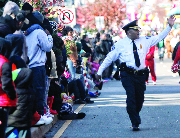 Chief Durham waves to the crowd as he takes part in Richmond's 2015 Christmas Parade. In typical fashion, he is walking, rather than riding, along the two-mile route.