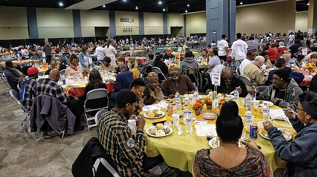 Thousands of people enjoy last year's Thanksgiving feast put on by The Giving Heart at the Greater Richmond Convention Center that is open to the Richmond community.