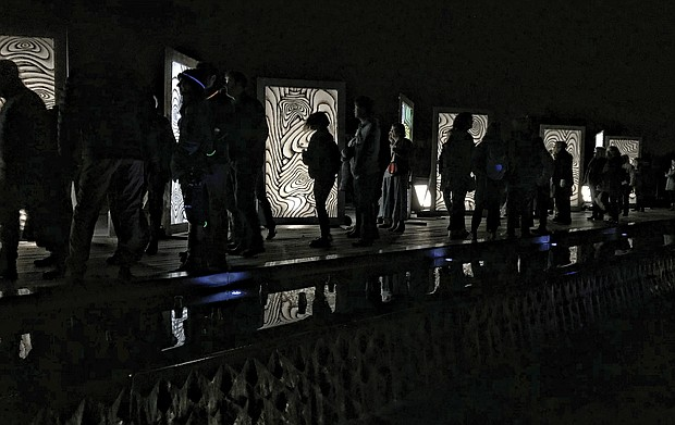 A variety of innovative art pieces adorn the grounds of the Virginia Museum of Fine Arts' Sculpture Garden during InLight Richmond, the 11th annual light-based show of art and performances sponsored by the 1708 Gallery last weekend. (James Haskins/Richmond Free Press)