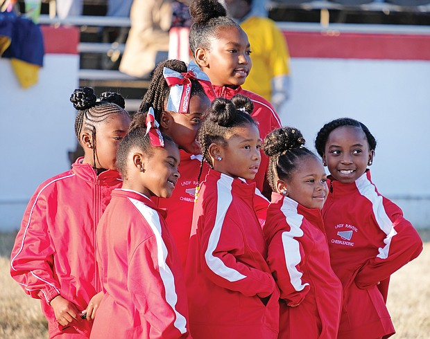 Poised and ready: Cheerleaders with the Reid Community Center Ravens strike a pose after cheering for their football teams playing in the Richmond Parks, Recreation and Community Facilities football championship games last Saturday at City Stadium. (Sandra Sellars/Richmond Free Press)