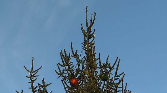 Residents protest removal of cross from top of Christmas ...