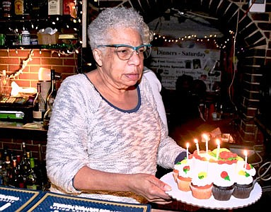 "Veronica ""Ronnie"" Jackson, the owner of Roots Lounge for over 40 years and still going strong presents Birthday cake to ""Rambling Rose."""