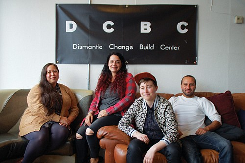 Social justice and communities of color advocates Cory Lira (from left), Myell Thompson, Anna Swanson and Mohamed Shehk promote the opening of the Dismantle, Change, Build Center, a new community gathering space in the former In Other Words feminist bookstore located at the corner of  Northeast Killingsworth and Williams Avenue.