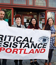 Volunteers with Critical Resistance Portland have a home in a new community gathering space open to multiple social justice organizations and communities of color at 14 N.E.  Killingsworth St. Pictured are Mohamed Shehk (from left), Anna Swanson, Myell Thompson and Cory Lira.