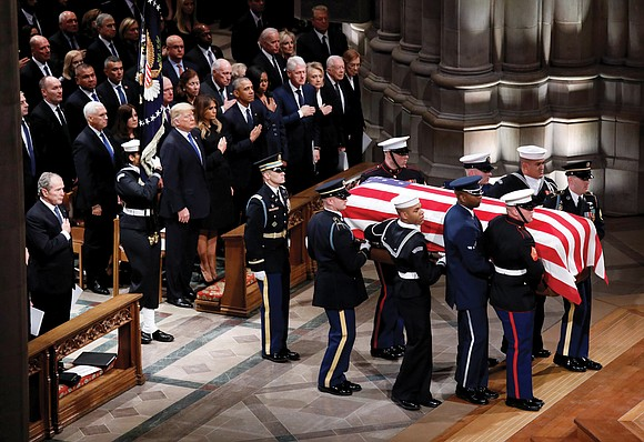 Former President George H.W. Bush was celebrated with high praise and loving humor Wednesday at a farewell to the man ...