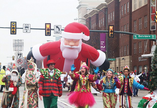 Holiday cheer: Thousands of spectators turned out last Saturday for the 35th Annual Christmas Parade in Richmond. Dozens of huge balloon characters, floats, marching bands and Santa made their way along Broad Street from the Science Museum of Virginia east to the Richmond Coliseum in Downtown to the smiles and cheers of people of all ages. (Regina H. Boone/Richmond Free Press)