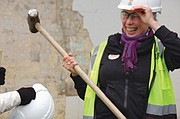 Cully resident Annette Pronk takes a sledge hammer to the former Sugar Shack on Monday, joining other women in the community during a ceremony to mark its deconstruction and the end to a blighted piece of property known for prostitution and other criminal activity.