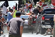 In this photo from Aug. 12, 2017, newspaper photographer Ryan M. Kelly captures the moment when driver James A. Fields Jr. plows into the crowd of counterprotesters during a white supremacist rally in Charlottesville.